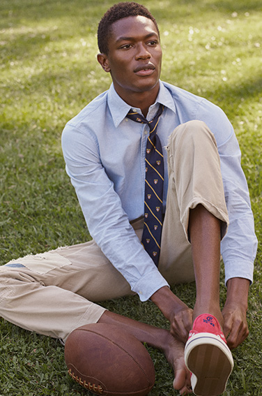 Man on lawn in tan pants paired with light blue oxford