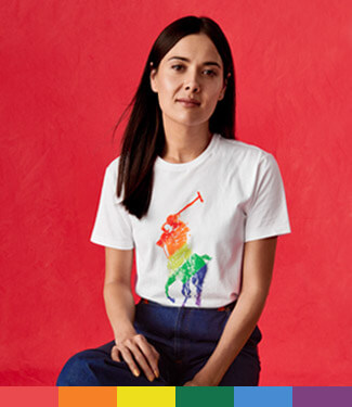 Patti Harrison in white tee with large rainbow Polo Pony graphic