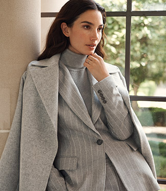 Woman in grey pinstripe suiting