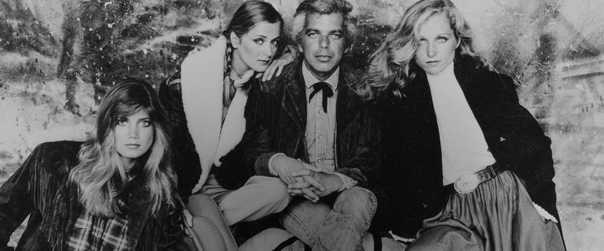 Black & white photo of Ralph Lauren in sport coat & jeans