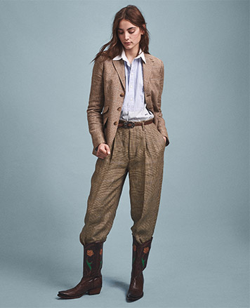 Woman in herringbone, menswear-inspired trousers