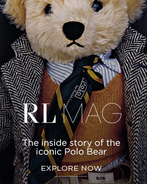 Close-up image of Polo Bear in blazer, sweater, and tie.