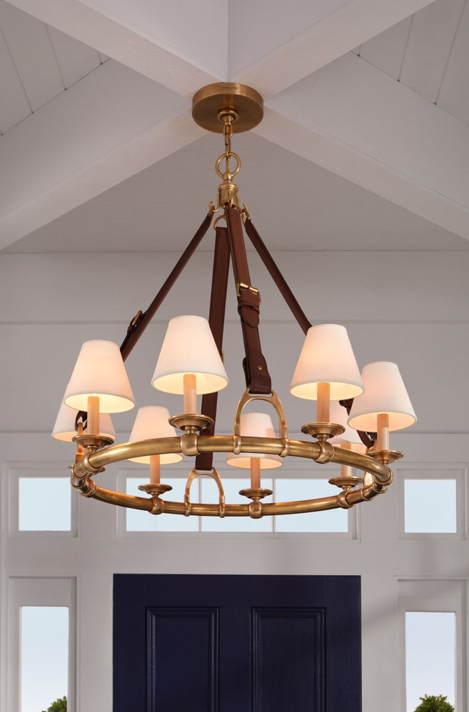 Chandelier with brown leather belt-inspired straps & lights with lamp shades.