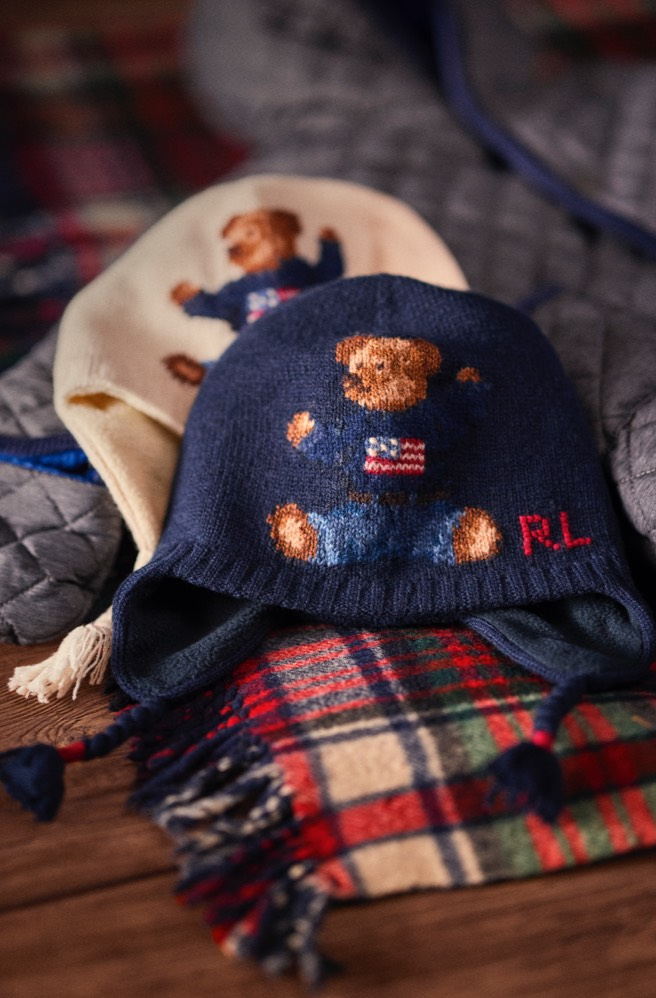 Navy & cream earflap hats featuring knit Polo Bear motifs.