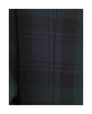 Close-up image of navy & green plaid coat