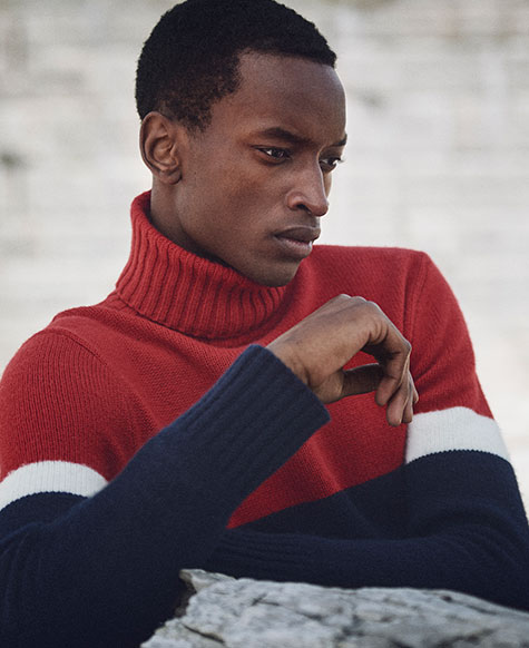 Man in red, white & blue color-blocked turtleneck sweater