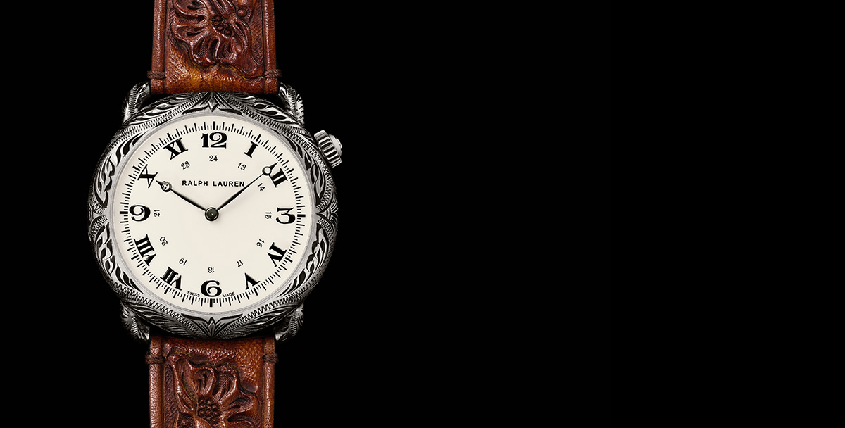 Rounded watch with intricate engraving & hand-tooled brown leather strap