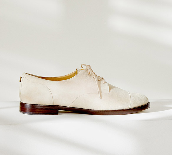 Cream-hued suede oxford shoe
