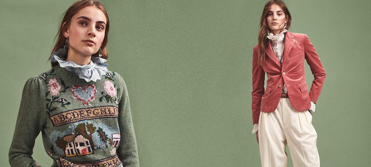 Woman in needlepoint sweater & woman in rose pink blazer