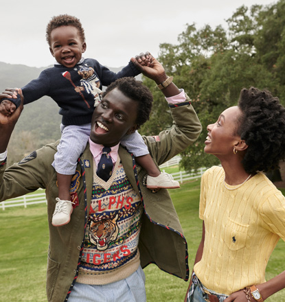 George carrying Zola on shoulders standing next to Yanii