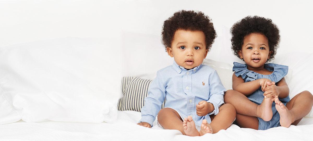 Baby boy in oxford shirt & baby girl in chambray romper