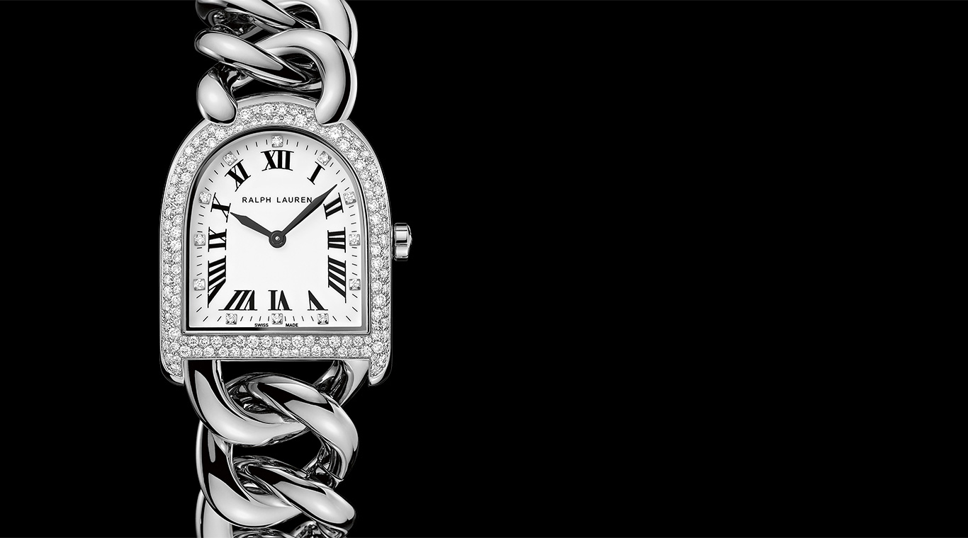 Stirrup watch with diamonds and chain-link bracelet & two women in black