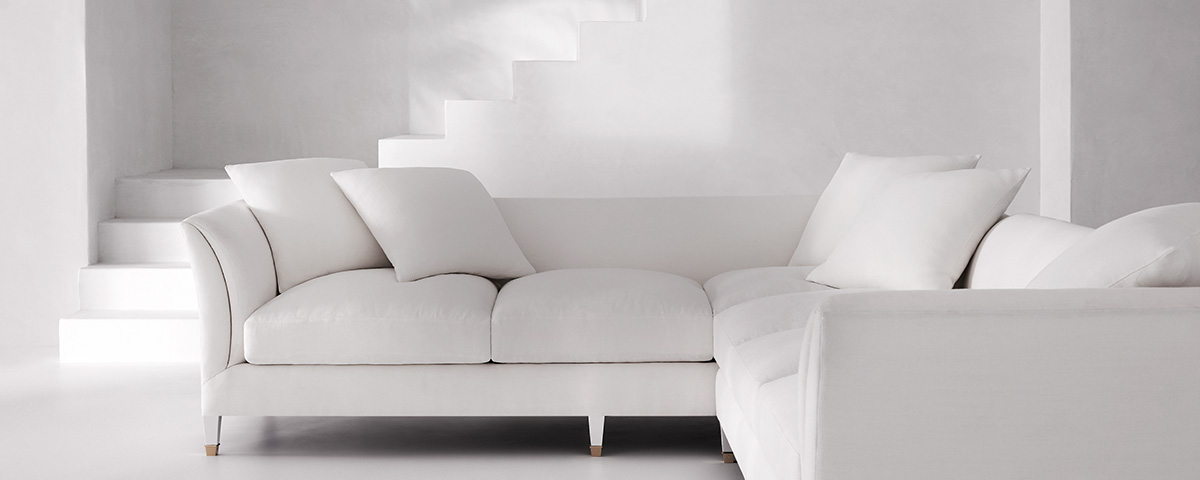 Crisp white sectional couch with matching cushions