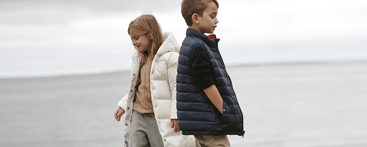 Girl in white down coat & boy in navy down vest