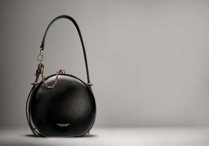 Black circle bag with gold chain accent