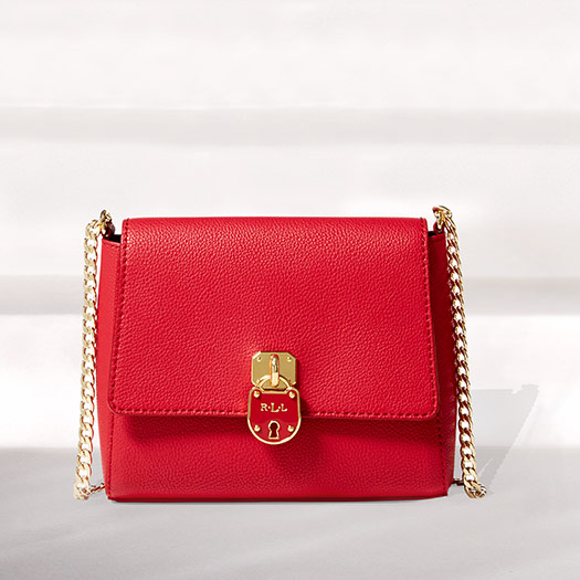 Red leather shoulder bag with chain strap and lock closure