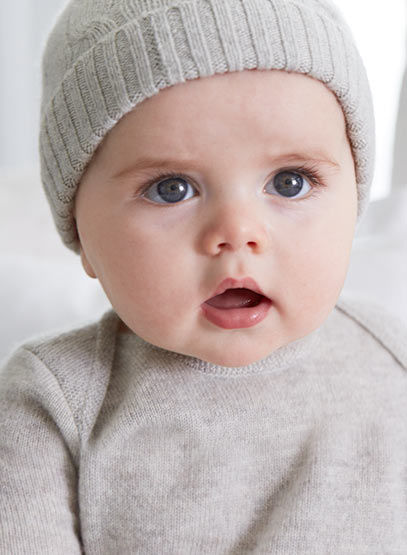 Baby in grey cashmere knit cap & matching bunting