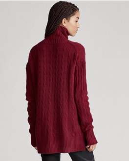 Deep red cable-knit turtleneck sweater