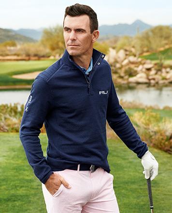 Billy Horschel in navy RLX half-zip pullover