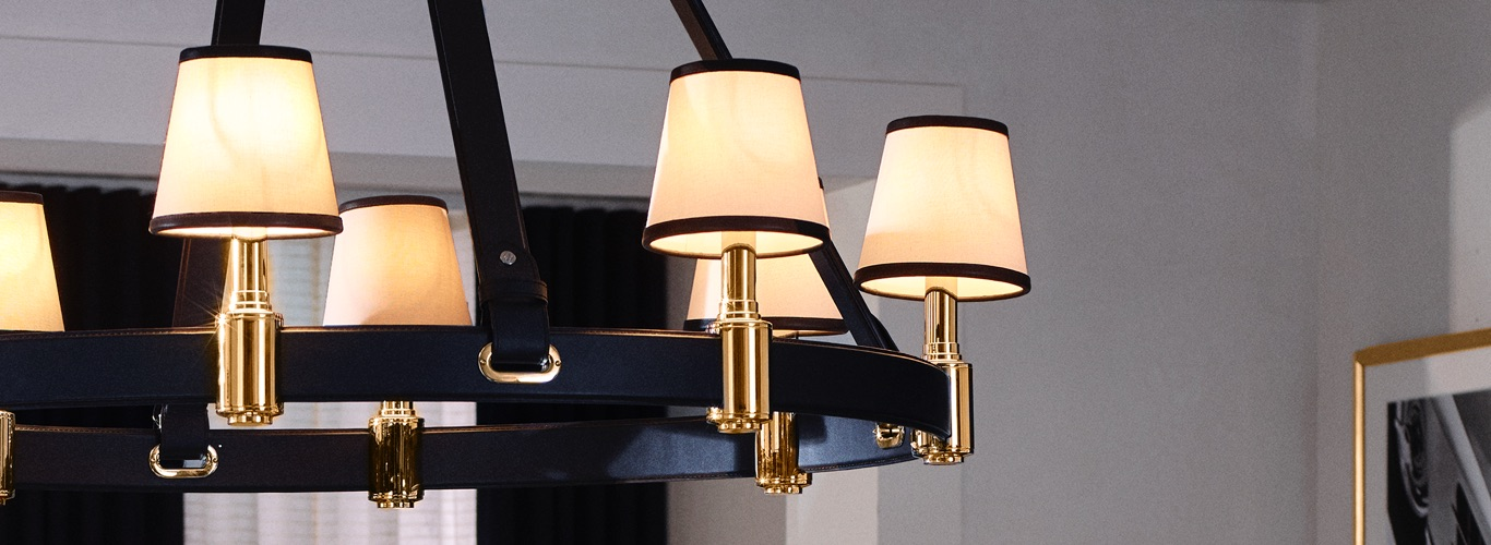 Sconce chandelier with black leather belt accents
