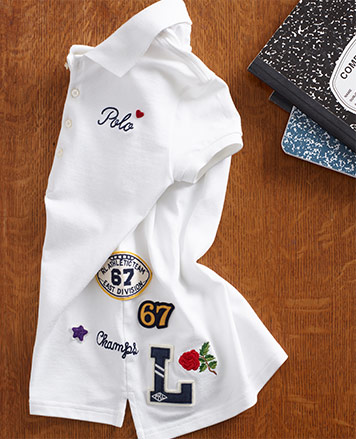 White Polo shirt with various patches.