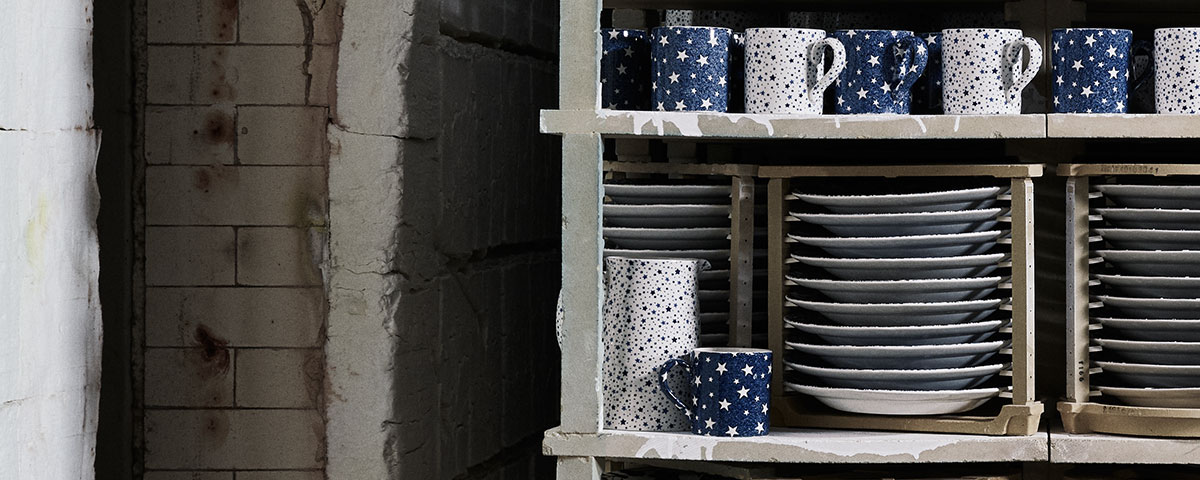 Shelves filled with navy & white star-print mugs and dishes