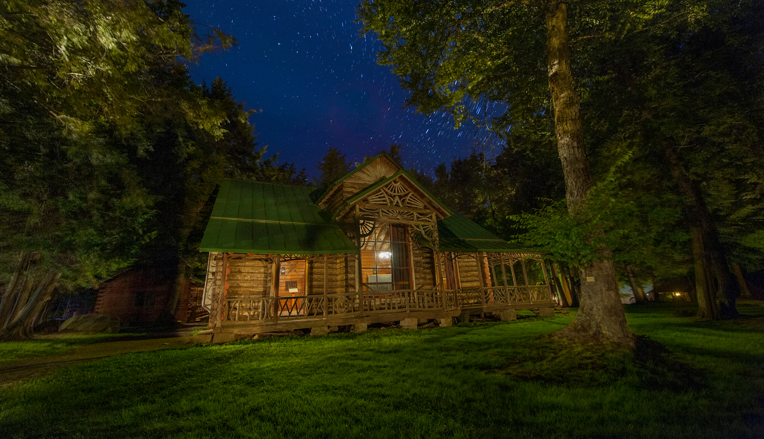 Seen here at night, Great Camp Pine Knot became William West Durant's most enduring legacy