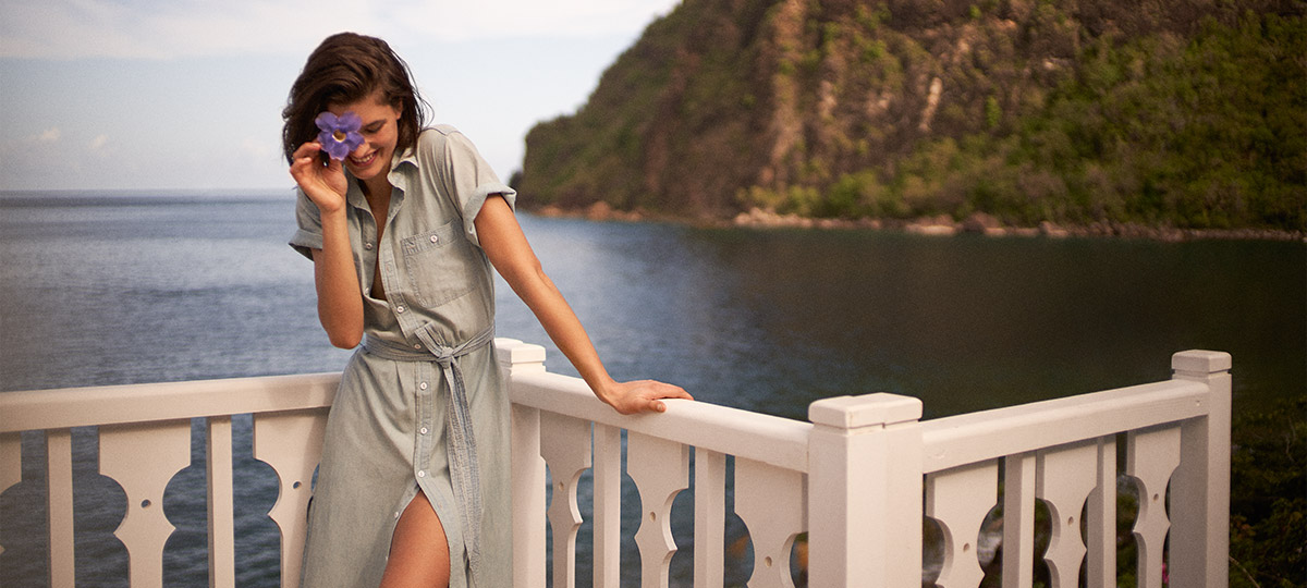 Woman on balcony in chambray shirtdress with tie at waist