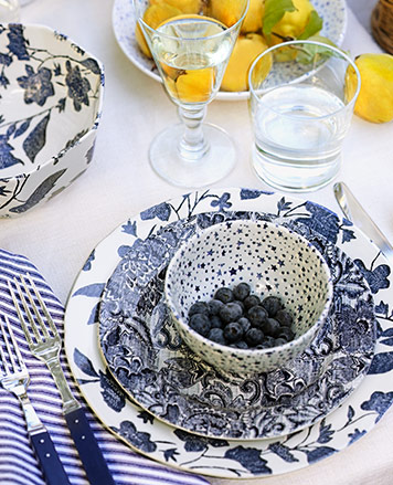 Star-pattern bowl teamed with floral- and vine-motif plates