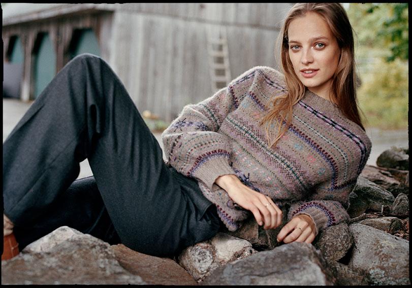 Woman in Fair Isle sweater & wide-leg pants