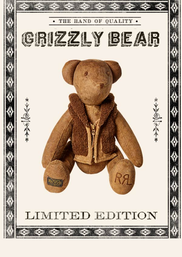 Stuffed bear wearing  shearling-style vest