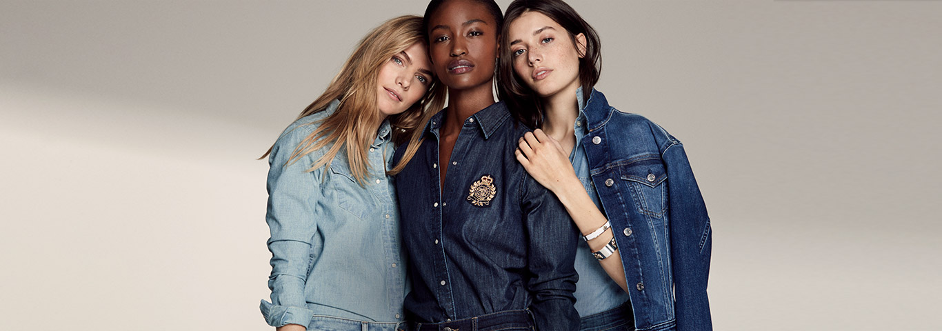 Three woman photographed together in denim of different hues