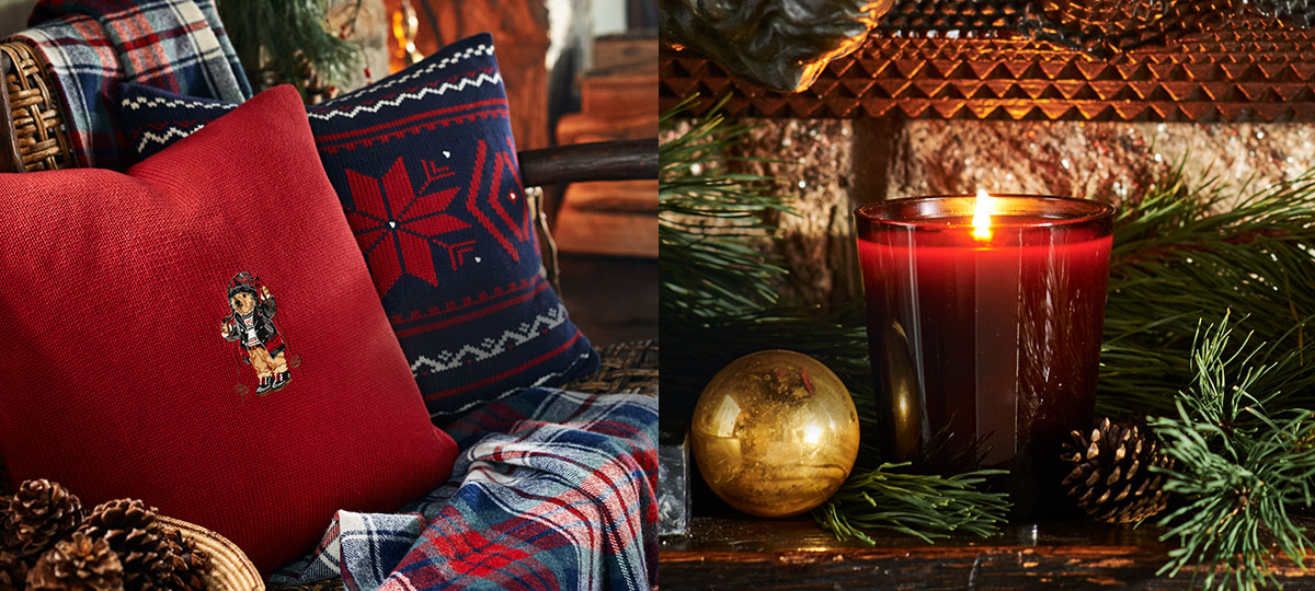 Festive pillows on wood bench; lit candle surrounded by pine needles & ornament