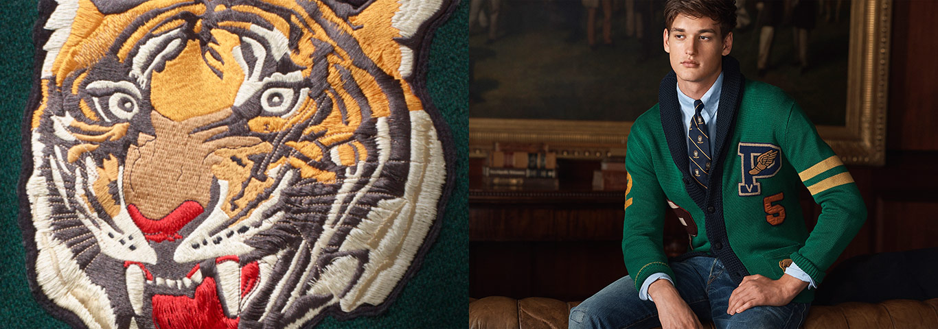 Close-up of embroidered tiger patch; man wears varsity-inspired cardigan  with club. Polo Ralph Lauren
