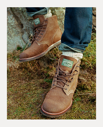 Weathered brown leather hiking boots