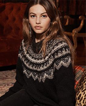 Woman in dark Nordic sweater.