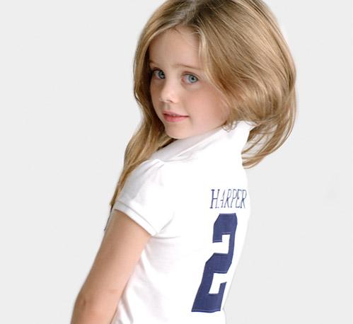Girl wears customized white Polo shirt.