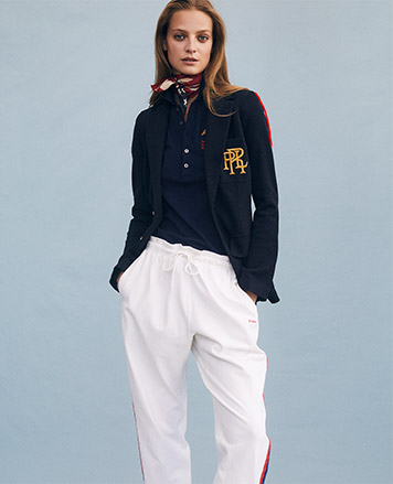 Model in white drawstring pants with stripes at sides