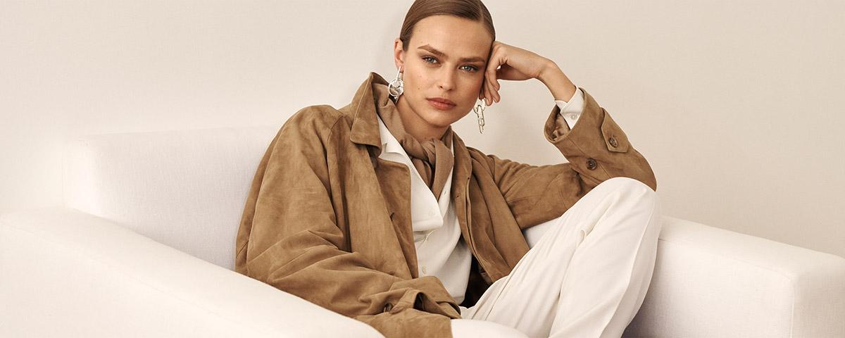 Woman in camel-hued suede oversize jacket