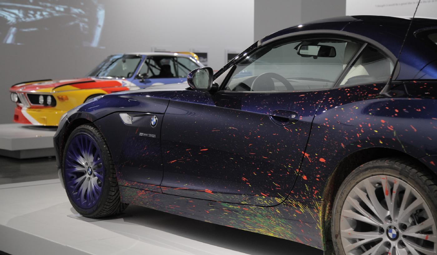 The 2009 BMW Z4 Roadster that artist Robin Rhode drove across a massive canvas (foreground) and a 1975 BMW 3.0 CSL painted by Alexander Calder are both part of the museum's BMW Art Cars collection