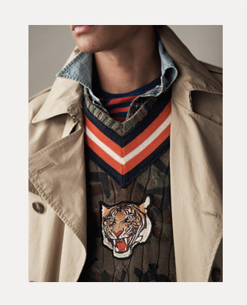 Camo sweater with tiger patch and contrast striped trim at V-neck