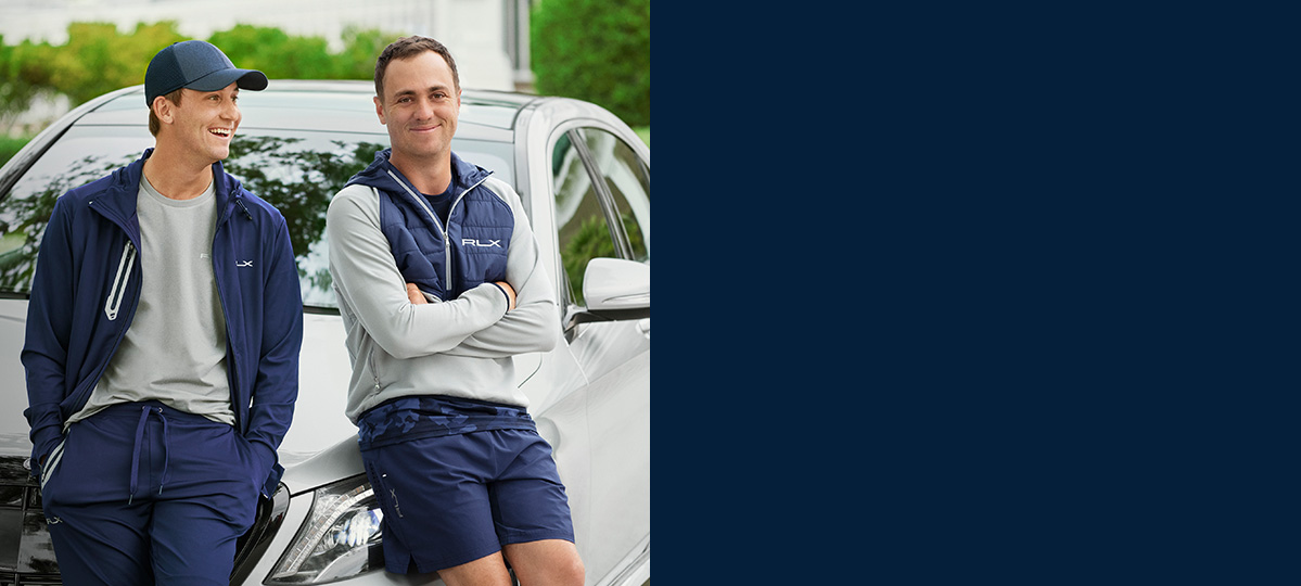 Justin Thomas in half-zip with navy quilting & grey jersey sleeves