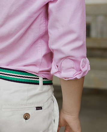 d144ee4c8091 Close-up image of boy wearing light-pink long-sleeve oxford shirt and