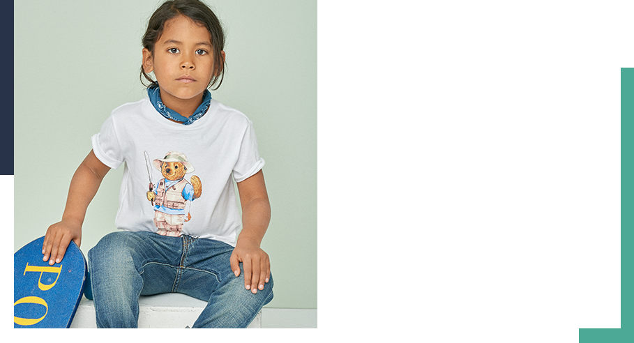 Boy wears Fishing Polo Bear T-shirt with rolled jeans and bandanna.