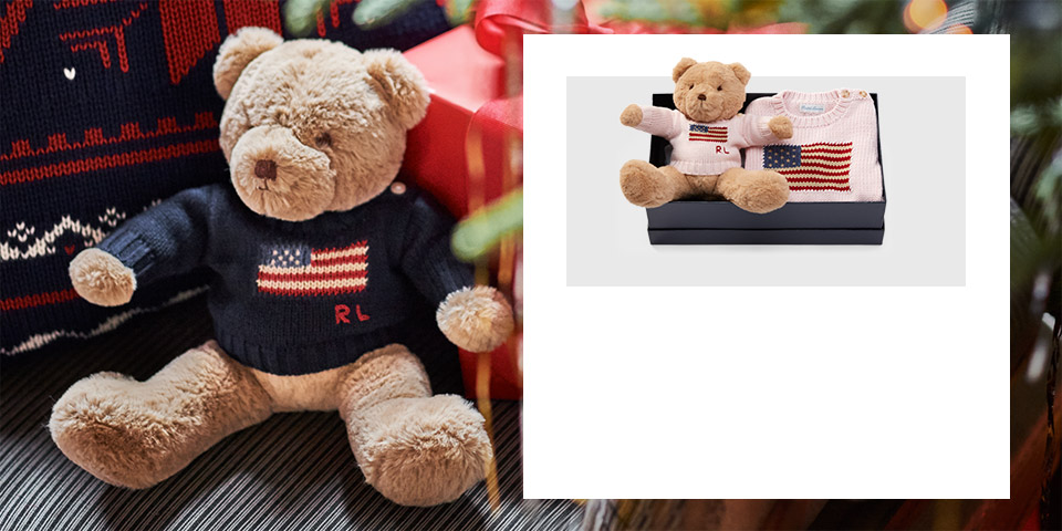 Brown bear wearing navy American flag sweater