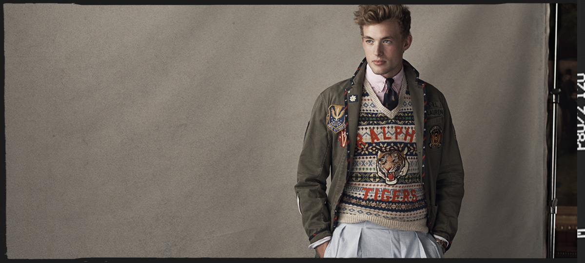 Man in Fair Isle sweater with tiger patch & army jacket
