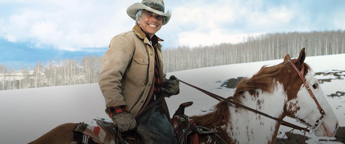 Mr. Lauren riding on horseback on snow-covered mountain