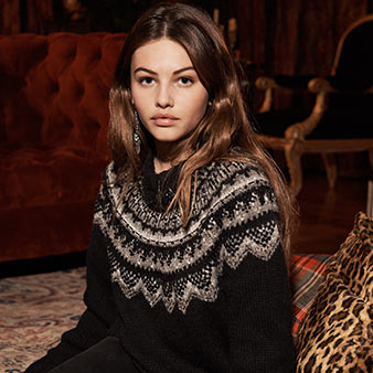 Beaded black sweater with white Nordic-inspired motif