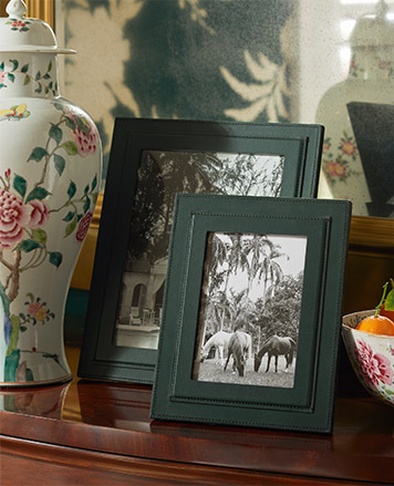 Dark green picture frame on table