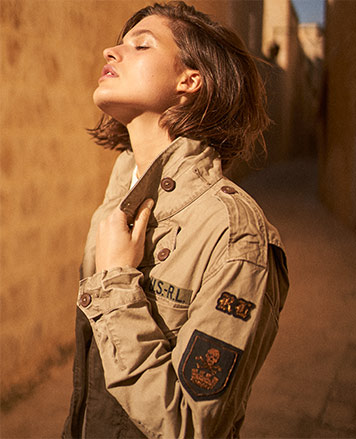 Woman in khaki military jacket